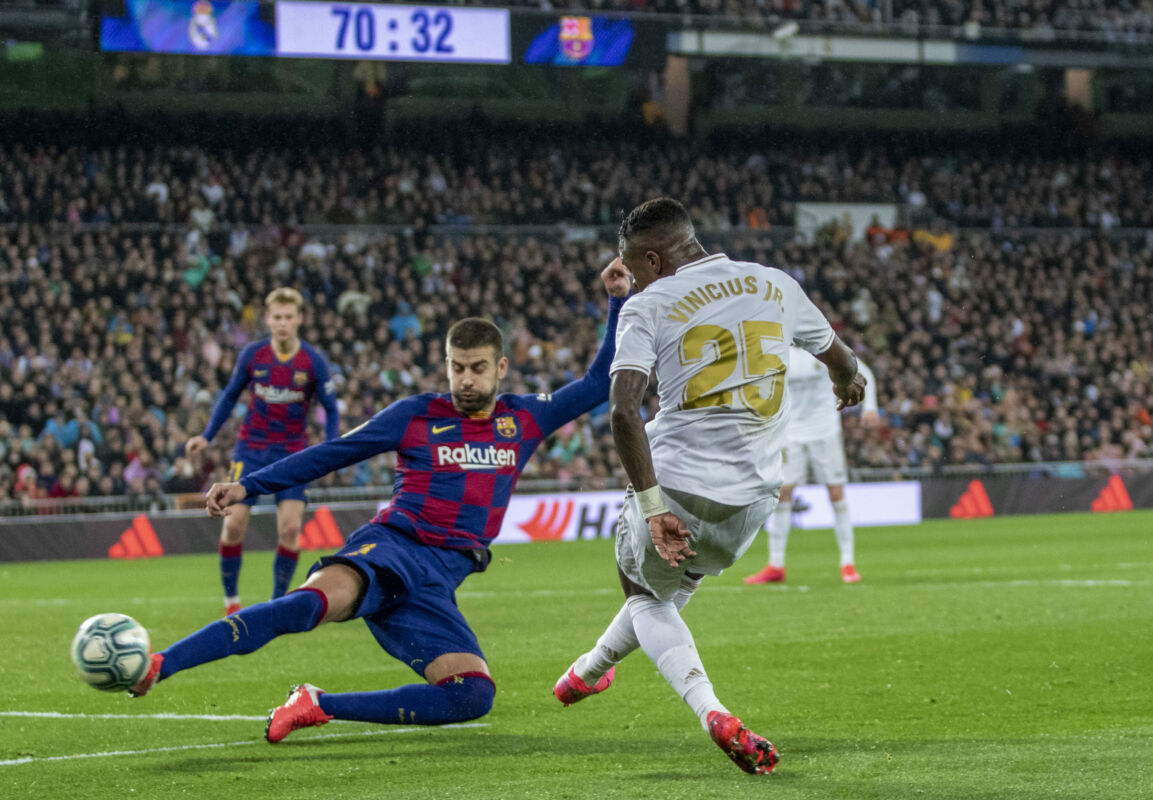 March 1, 2020, Madrid, Spain: Vinicius Jr of Real (R) in action during the Spanish La Liga match round 26 between Real Madrid and FC Barcelona at Santiago Bernabeu Stadium in Madrid..Final score: Real Madrid 2-0 Barcelona. (Credit Image: © Manu Reino/SOPA Images via ZUMA Wire)