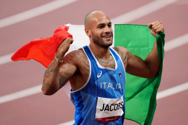 epa09385792 Lamont Marcell Jacobs of Italy celebrates after winning the Men's 100m final during the Athletics events of the Tokyo 2020 Olympic Games at the Olympic Stadium in Tokyo, Japan, 01 August 2021. EPA/JOE GIDDENS AUSTRALIA AND NEW ZEALAND OUT
