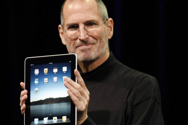 Apple CEO Steve Jobs shows off the new iPad during an event in San Francisco, Wednesday, Jan. 27, 2010. (AP Photo/Paul Sakuma)