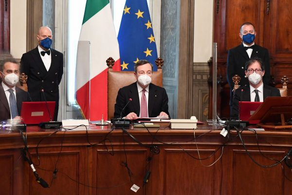 epa09009240 Italian Foreign Minister Luigi Di Maio (L), new Prime Minister Mario Draghi (C) and Undersecretary of State at the Presidency of the Council of Ministers, Roberto Garofoli (R), attend the first council of Ministers at Chigi Palace in Rome, Italy, 13 February 2021. Former European Central Bank (ECB) chief Mario Draghi has been sworn in on the day as Italy's prime minister after he put together a government securing broad support across political parties following the previous coalition's collapse.  EPA/ETTORE FERRARI / POOL