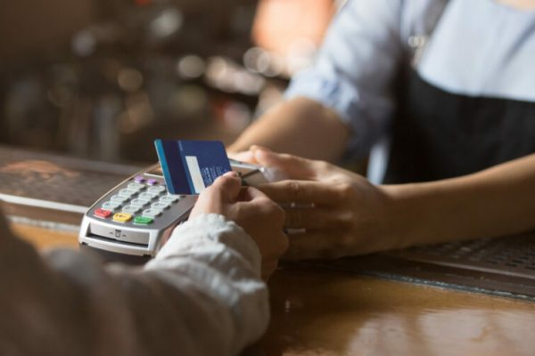 Contactless,Payment,Concept,,Female,Customer,Holding,Credit,Card,Near,Nfc