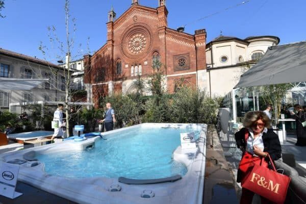 A woman walks past a Jacuzzi tub part of the Fuori Salone Design Week in Milan, Italy, 17 April 2018.The fair, running from 17 to 22 April, is considered the largest of its kind in the world, and presents the latest trends and designs on furniture, lighting and home accessories. ANSA/DANIEL DAL ZENNARO