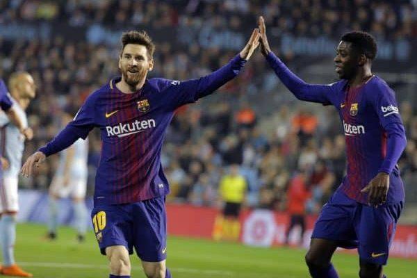 epa06675753 FC Barcelona's Lionel Messi (L) celebrates with teammate Ousmane Dembele (R) during the Spanish Primera Division soccer match between Celta de Vigo and FC Barcelona at Balaidos stadium, Vigo, Galicia, northern Spain, 17 April 2018. EPA/Lavandeira jr