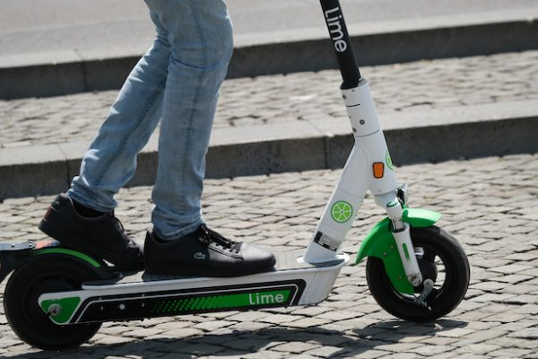 BERLIN, GERMANY - JUNE 25: A man rides a Lime electric scooter in the city center on June 25, 2019 in Berlin, Germany. Lime launched its scooter service in Berlin last week following the recent legalization of their use by the German government. (Photo by Sean Gallup/Getty Images)