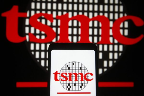 February 23, 2021, Ukraine: In this photo illustration, TSMC (Taiwan Semiconductor Manufacturing Company) logo seen displayed on a smartphone and pc screen. (Credit Image: © Pavlo Gonchar/SOPA Images via ZUMA Wire)