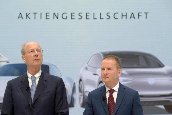 epa06665943 Volkswagen Chairman of the Supervisory Board Hans Dieter Poetsch (L) and new Volkswagen CEO Herbert Diess (R) attend a press conference after a Supervisory Board Meeting of the Volkswagen Group in Wolfsburg, Germany, 13 April 2018. The Board of Management and Supervisory Board of Volkswagen decided on 12 April 2018 to change their management structure including the replacement of the Chairman of the Groupâs Board of Management. EPA/JENS SCHLUETER