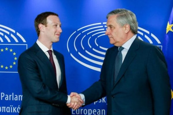 epa06756074 The founder and CEO of Facebook Mark Zuckerberg (L) is welcomed by EP President Antonio Tajani at the European Parliament ahead of an hearing at the European Parliament in Brussels, Belgium, 22 May 2018. Facebook CEO Mark Zuckerberg appeared before the European Parliament representatives to answer questions in a live broadcast on data information breach by Cambridge Analytica and also how Facebook uses personal data in general. EPA/STEPHANIE LECOCQ