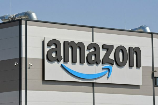 28 April 2021, Brandenburg, Kiekebusch: The logo of Amazon, (Amazon.com, Inc., listed US online mail order company), at the shipping warehouse in Kiekebusch, a district of the municipality of Schönefeld in the district of Dahme-Spreewald. Photo: Patrick Pleul/dpa-Zentralbild/ZB