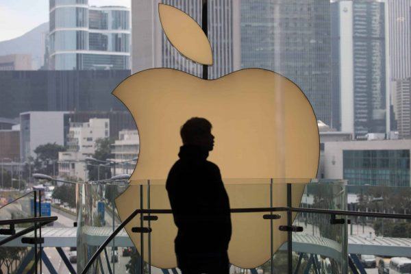 epa07260968 Shoppers walk past the Apple Inc. logo at an Apple Store in Hong Kong, China, 04 January 2019. In a letter to investors earlier this week, Apple Inc. chief executive Tim Cook said the firm's sales problems were primarily in its Greater China region, which includes Hong Kong and Taiwan and accounts for almost 20 percent of its revenue. EPA/JEROME FAVRE