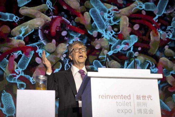 Bill Gates, former Microsoft CEO and co-founder of the Bill and Melinda Gates Foundation, speaks as a jar of human feces sits on a podium at the Reinvented Toilet Expo in Beijing, Tuesday, Nov. 6, 2018. With a jar of human feces on a podium next to him, billionaire philanthropist Bill Gates has kicked off a