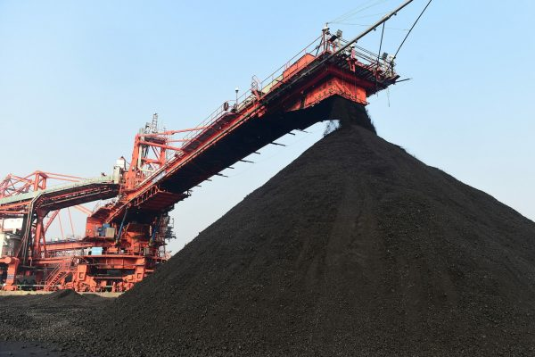 CANGZHOU, Dec. 23, 2020 Photo taken on Dec. 22, 2020 shows a thermal coal yard of Huanghua Port in Cangzhou City, north China's Hebei Province. Huanghua Port, one of the key ports for thermal coal transportation in China, has stepped up its turnover rate since this December. A daily average of 500,000 tonnes of thermal coal is loaded to ships at the port now to quench the thirst for coal-fired power generation in southern parts of the country. (Credit Image: © Wang Min/Xinhua via ZUMA Press)