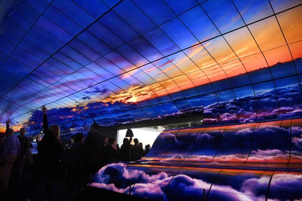 LAS VEGAS, Jan. 9, 2019 Visitors watch a giant curved display of LG during the Consumer Electronics Show (CES) in Las Vegas, the United States, on Jan. 8, 2019. 2019 CES highlights new displays from global companies, such as LG, Samsung and Sharp. CES, the world's largest trade show to present new products and technologies in the consumer electronics industry, runs till Friday, attracting about 4,500 exhibitors and 180,000 attendees in 2019. (Credit Image: © Liu Jie/Xinhua via ZUMA Wire)