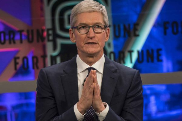 epa06370627 Tim Cook, the CEO of Apple, speaks during the Fortune 500 Global Forum in Guangzhou, Guandong Province, China, 06 December 2017. Before being named CEO in August 2011, Tim was Apple's Chief Operating Officer and was responsible for all of the company's worldwide sales and operations. EPA/ALEKSANDAR PLAVEVSKI