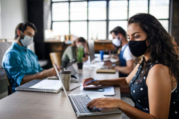 Business,People,With,Face,Masks,Indoors,In,Office,,Back,To