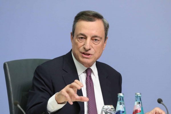 epa06290713 Mario Draghi, the President of the European Central Bank (ECB), gives a press conference in Frankfurt am Main, Germany, 26 October 2017. The European Central Bank announced it would keep its lending rate at zero per cent and extends its ongoing bond-buying scheme but reduces the scope from 60 billion euro to 30 billion euro as part of its monthly quantitative easing programme as a major policy shift. The new policy is to take effect as of January 2018 and lasts at least until September. EPA/ARMANDO BABANI