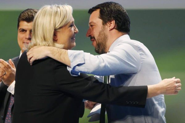 French National Front president Marine Le Pen, left, hugs Italy's Northern League leader Matteo Salvini during the Europe of Nations and Freedom movement meeting in Milan, Italy, Thursday, Jan. 28, 2016. (ANSA/AP Photo/Antonio Calanni)