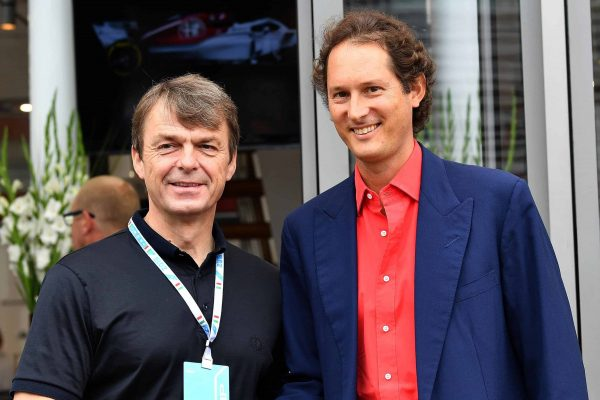 FCA group president John Elkann (R) shakes hand with FAC group Michael Manley, at paddock prior to the start of the Formula One Italy Grand Prix at the Monza racetrack, Italy,2 September 2018.ANSA/DANIEL DAL ZENNARO