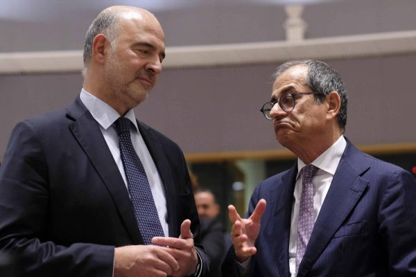 epa07703516 Pierre Moscovici (L), the European Commissioner for Economic and Financial Affairs and Taxation, talks with Italian Minister of Economy and Finance, Giovanni Tria, during the Eurogroup Finance Ministers' meeting in Brussels, Belgium, 08 July 2019. EPA/OLIVIER HOSLET