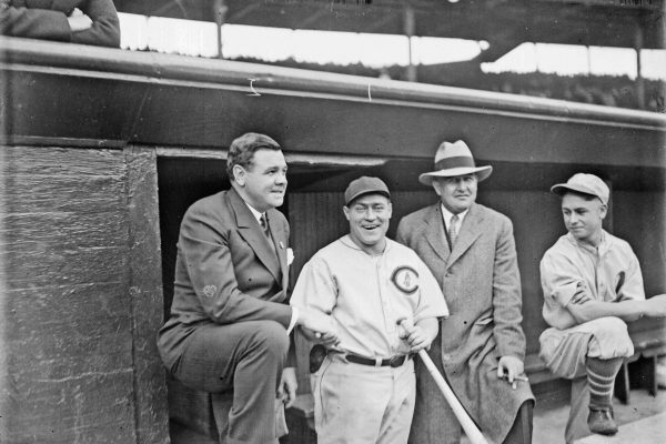 1929 - Chicago, Illinois, U.S. - Informal three-quarter length group portrait of baseball players HACK WILSON of the National League's Chicago Cubs, and BABE RUTH of the American League's New York Yankees, standing in a dugout at Wrigley Field in Chicago, Illinois, before a 1929 World Series game between the Cubs and the American League's Philadelphia Athletics. Ruth is wearing street clothes. An unidentified man wearing street clothes and an unidentified Philadelphia player are standing in the dugout. Wrigley Field is located at 1060 West Addison Street and bounded by West Waveland Avenue, North Seminary Avenue, North Clark Street, and North Sheffield Avenue in the Lake View community area. (Credit Image: © Chicago History Museum/ZUMAPRESS.com)