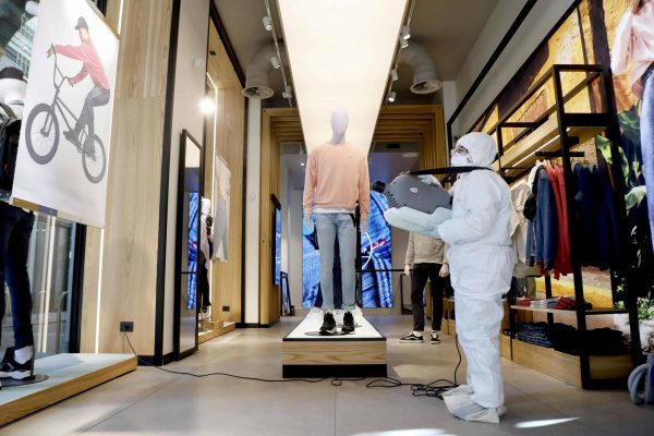 A private company employee sanitizes a clothing store in the center of Milan ahead of phase 2 of the gradual reopening of commercial activities during the Coronavirus emergency in Milan, April 22, 2020. ANSA/Mourad Balti Touati