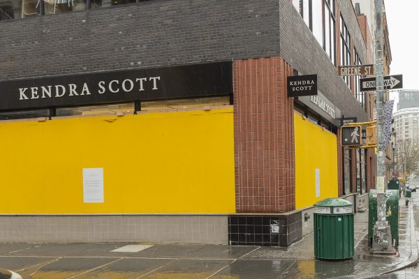 March 28, 2020, New York, New York, United States: Some high end stores like Kendra Scott on Greene Street boarding up with plywood windows and entrances to prevent looting in Manhattan (Credit Image: © Lev Radin/Pacific Press via ZUMA Wire)