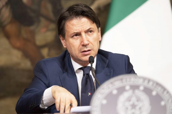 epa08420434 A handout photo made available by the Chigi Palace Press Office shows Italian Prime Minister, Giuseppe Conte, attending a press conference during a break of the Cabinet for the