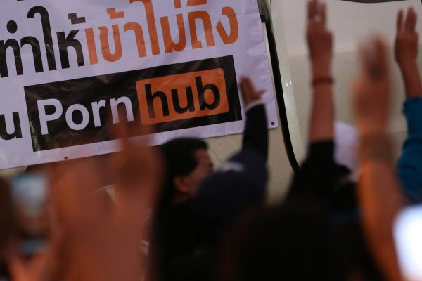 epa08795288 Thai protesters flash the three-finger salute as they gather for protest following the blocking access of the adult website Pornhub, outside the Ministry of Digital Economy and Society in Bangkok, Thailand, 03 November 2020. Thai protest gather at the Ministry of Digital Economy and Society after the Pornhub is being blocked from access in Thailand by the Ministry of Digital Economy and Society on 03 November, due to claims of the site's violation of the Computer Crimes Act. EPA/NARONG SANGNAK