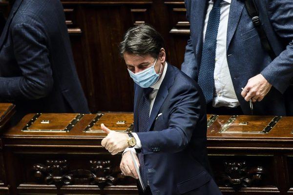 Il presidente del Consiglio Giuseppe Conte in aula al termine del voto della Legge di Bilancio 2021, Roma, 27 dicembre 2020. ANSA/ANGELO CARCONI