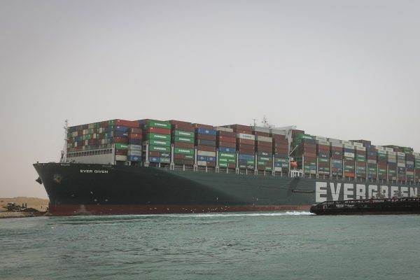 HANDOUT - 25 March 2021, Egypt, Suez: A tugboat sails past the