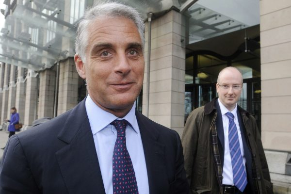 epa03528729 Andrea Orcel (L) the head of the UBS investment bank, and Andrew Williams (R) Global head of Compliance leave Portcullis House after giving evidence to the UK Parliamentary banking inquiry on Libor interest rates in London, Britain, 09 January 2013. EPA/FACUNDO ARRIZABALAGA
