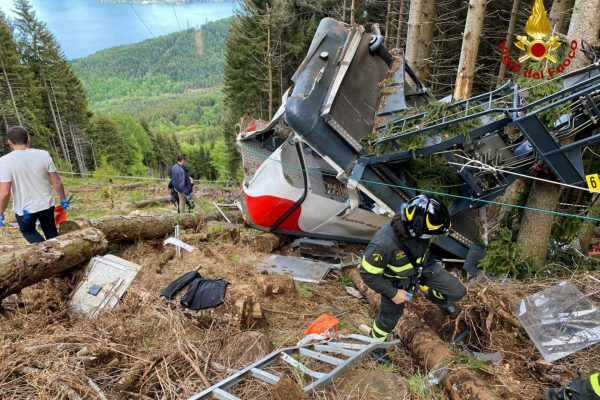 epa09223878 A handout photo made available by Italian Fire and Rescue Service shows Rescuers at work at the area of the cable car accident, near Lake Maggiore, northern Italy, 23 May 2021. The cable car that connects Stresa with Mottarone has crashed, claiming 14 lives, according to the latest toll. The accident has been caused by the failure of a rope, in the highest part of the route which, starting from Lake Maggiore reaches an altitude of 1,491 meters. EPA/ITALIAN FIRE AND RESCUE SERVICE / HANDOUT HANDOUT EDITORIAL USE ONLY/NO SALES