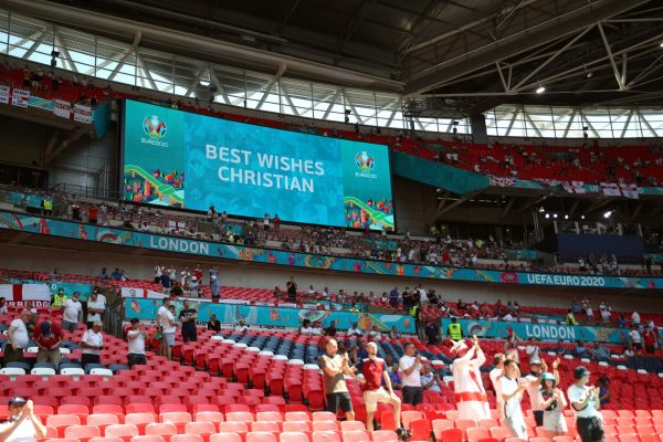 epa09266951 A message reading 'Best Wishes Christian' dedicated to Danish soccer player Christian Eriksen is shown on a huge screen prior to the UEFA EURO 2020 group D preliminary round soccer match between England and Croatia at Wembley stadium in London, Britain, 13 June 2021. EPA/Carl Recine / POOL (RESTRICTIONS: For editorial news reporting purposes only. Images must appear as still images and must not emulate match action video footage. Photographs published in online publications shall have an interval of at least 20 seconds between the posting.)