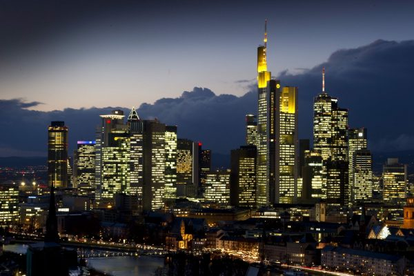 epa03027369 The evening skyline of Frankfurt, Germany, is dominated by the illuminated banking skyscrapers on 07 December 2011 evening. The results of a stress test of the European Banking Authority (EBA) on German and European banks is expected to be announced on 08 December 2011 in London. EPA/BORIS ROESSLER