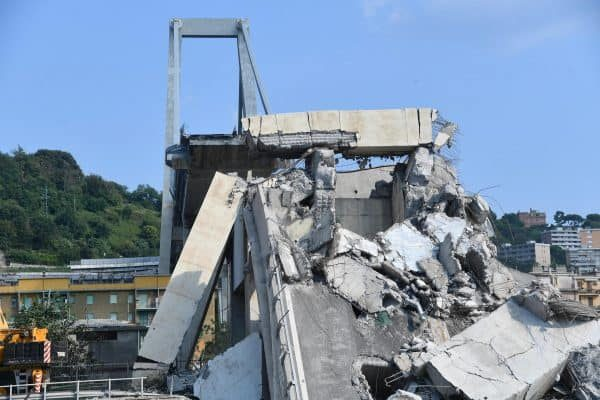 A general view showing a part of the partially collapsed Morandi bridge, in Genoa, Italy, 19 August 2018. Italian authorities, worried about the stability of remaining large sections of the bridge, evacuated about 630 people from nearby apartments. ANSA/LUCA ZENNARO