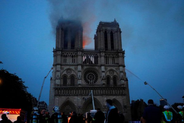 epa07508845 Paris Fire brigade members spray water onto the facade of the Notre Dame Cathedral during the visit by French President Emmanuel Macron (not pictured) in Paris, France, 15 April 2019. A fire started in the late afternoon in one of the most visited monuments of the French capital. EPA/PHILIPPE WOJAZER / POOL MAXPPP OUT