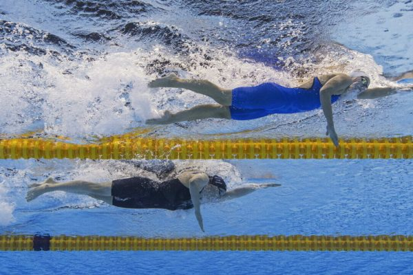 epa09367619 (From Top) Viktoria Mihalyvari-Farkas of Hungary and Julia Hassler of Liechtenstein compete in the women's 1500m Freestyle Heats during the Swimming events of the Tokyo 2020 Olympic Games at the Tokyo Aquatics Centre in Tokyo, Japan, 26 July 2021. EPA/Patrick B. Kraemer
