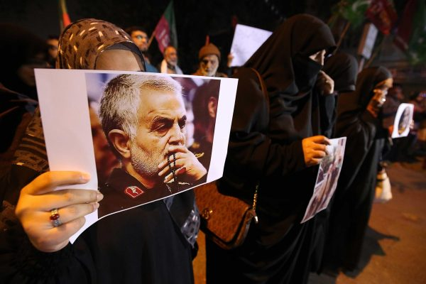 epa08100430 Pakistani Shiite Muslims hold pictures of General Qasem Soleimani, the head of Iran's Islamic Revolutionary Guard Corps' elite Quds Force, during a protest against the USA, in Karachi, Pakistan, 03 January 2020. General Qasem Soleimani was killed in an airstrike in Baghdad on 03 January, ordered by the United States' president, the Pentagon said. General Soleimani was in charge of Iran's foreign policy strategy as the head of the Quds Force, an elite wing of the Islamic Revolutionary Guard Corps, which the US designated as a terror organization. The Quds Force holds sway over a raft of Shia militias across the region, from Lebanon to Syria and Iraq. EPA/SHAHZAIB AKBER