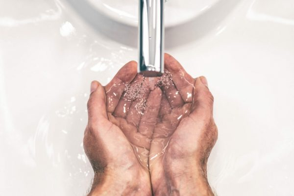 Covid-19,Coronavirus,Prevention,Washing,Hands,With,Soap,At,Bathroom,Sink