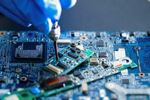 E-waste,,Technician,Repairing,Inside,Of,Hard,Disk,By,Soldering,Iron.
