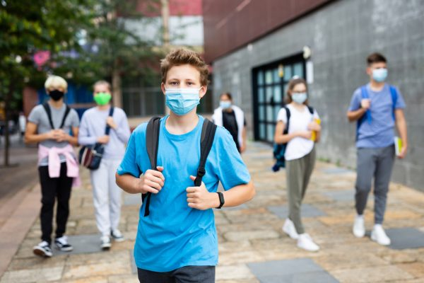 Portrait,Of,Teenager,In,Protective,Mask,With,Backpack,Going,To