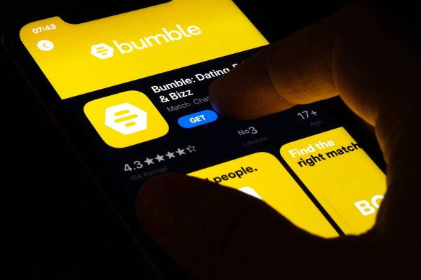 Hand,Holding,A,Smartphone,With,A,Bumble,Dating,App,On