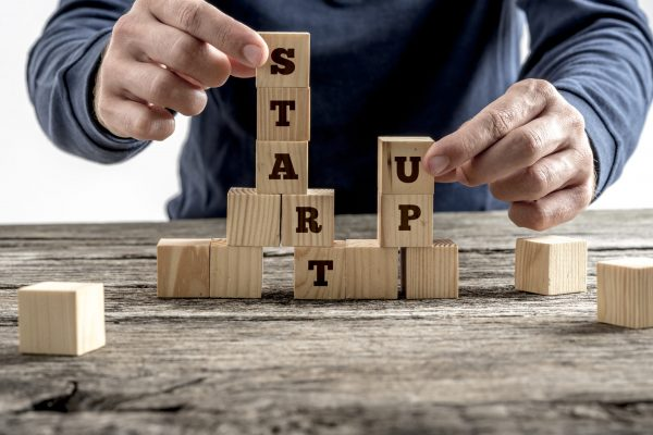 Front,View,Of,A,Businessman,Arranging,Wooden,Cubes,In,A