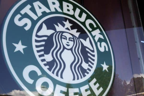 epa06680565 Starbucks signage in front of the store's window in Oakland, California, USA, 19 April 2018. Starbucks will be closing 8,000 stores in late May for several hours across the United States to conduct racial-bias training for workers after Starbucks Corp. issued an apology following the arrest of two black men at a store in Philadelphia, Pennsylvania. EPA/JOHN G. MABANGLO