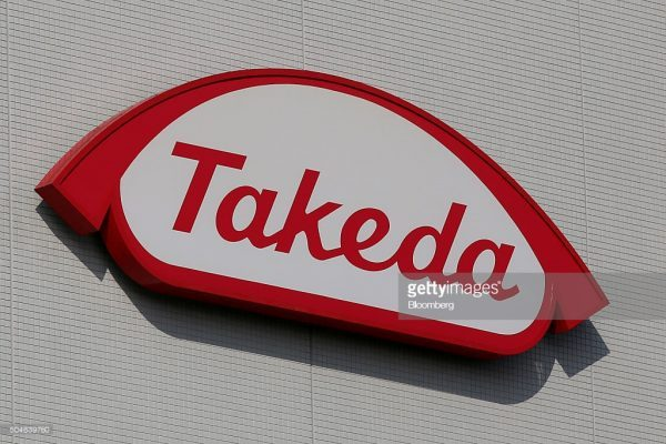 The Takeda Pharmaceutical Co. logo is displayed at it's Shonan Research Center in Fujisawa, Kanagawa Prefecture, Japan, on Tuesday, Dec. 15, 2015. With about 1.78 trillion yen ($15 billion) in annual revenue, Takeda ranks 18th among the 20 largest pharma companies worldwide. Photographer: Yuriko Nakao/Bloomberg